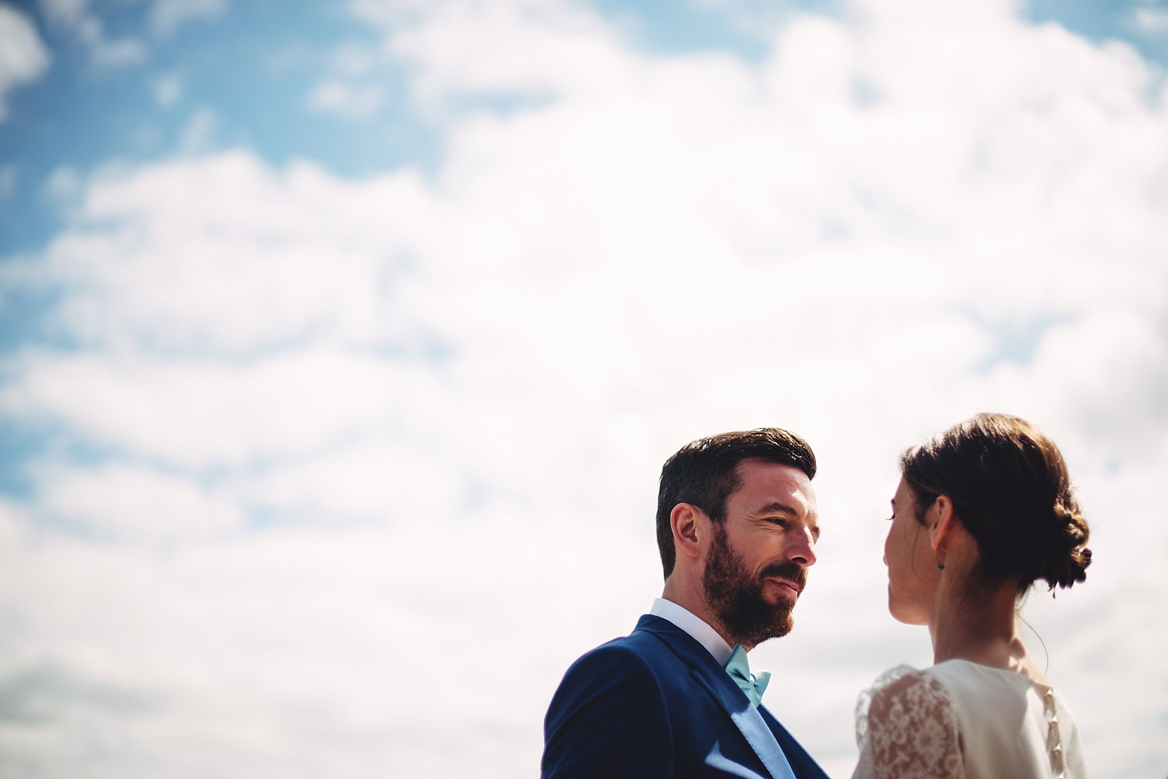 Bride and groom set against a lovely sky