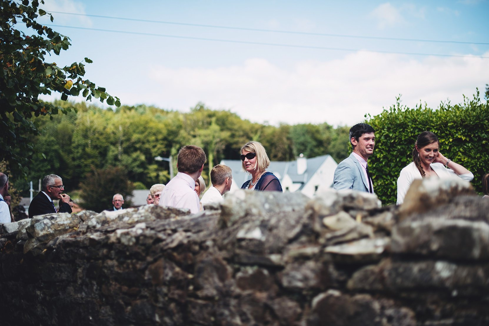 Guests outside a church at a wedding
