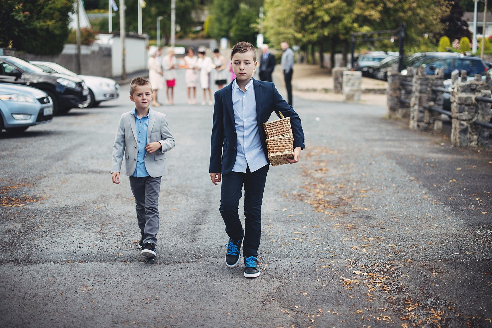 Pageboys at a wedding with the wedding booklets