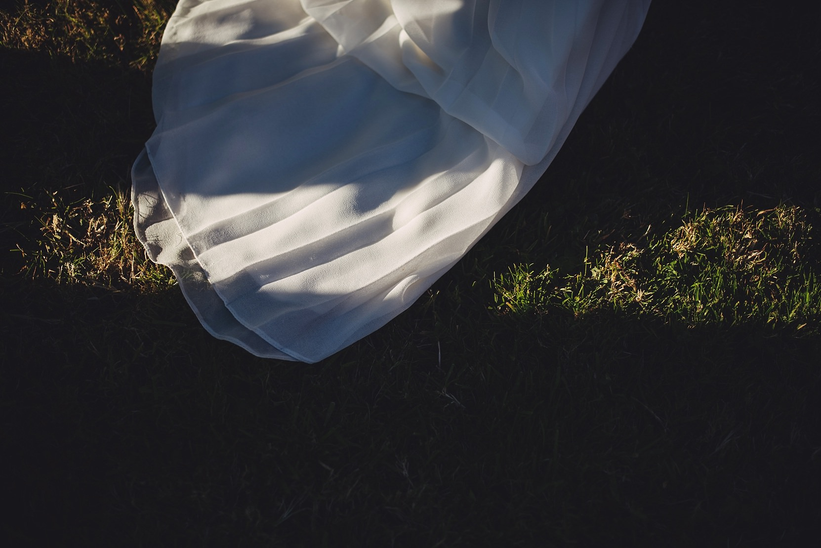 The brides dress in great light at a wedding