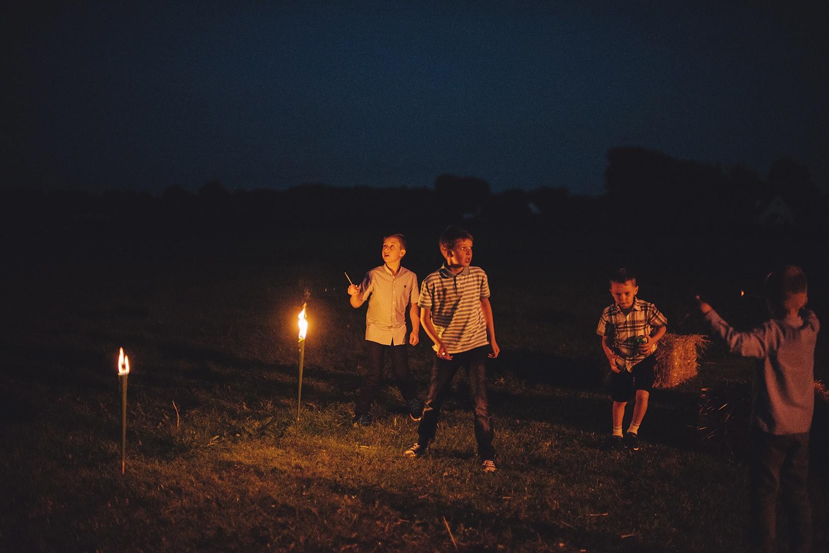 Kids at a wedding at night outside