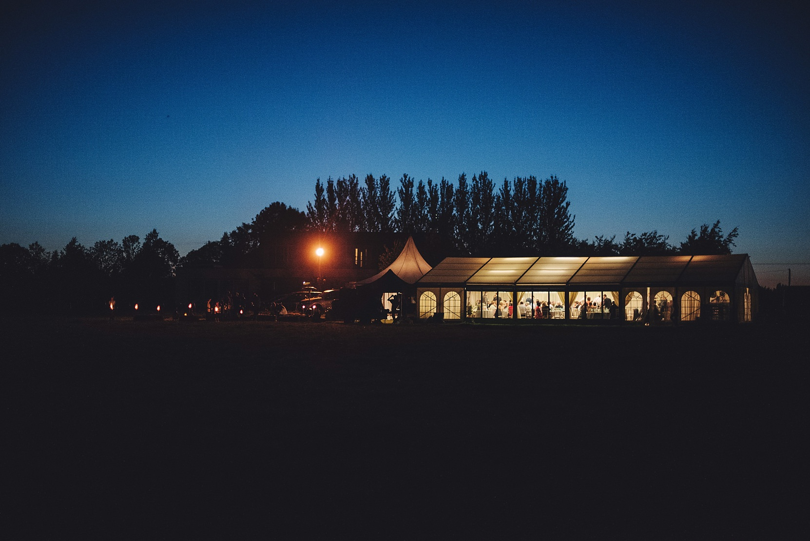 A marquee wedding at night from the outside