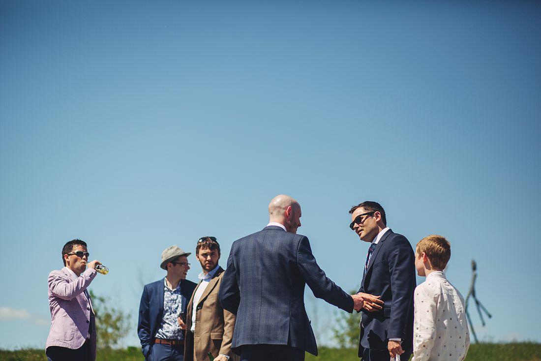 Groom meeting guests at wedding