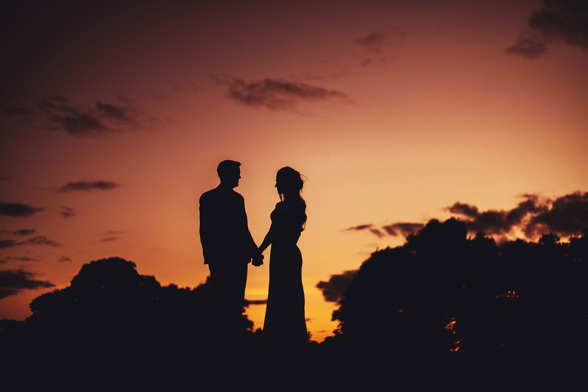Bride and Groom on a hill in sillhouette